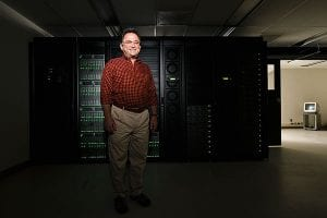 Miron Livny, a University of Wisconsin-Madison computer science professor, is pictured near an enclosed bank of distributed computing equipment in the Computer Sciences and Statistics building on July 28, 2008. The facility includes 1,100 CPU cores and nearly 400 terabytes of disk space, all connected directly to the backbone of the campus network. Livny specializes in distributed computing, which pools the computing power of thousands of processors to conduct number crunching at a huge scale. Livny leads a national initiative, called the Open Science Grid, that uses this ability to collect and divide data from the particle detector project at the European Organization for Nuclear Research (CERN) in Switzerland. ©UW-Madison University Communications 608/262-0067 Photo by: Jeff Miller Date:  07/08    File#:  NIKON D3 digital frame 7196
