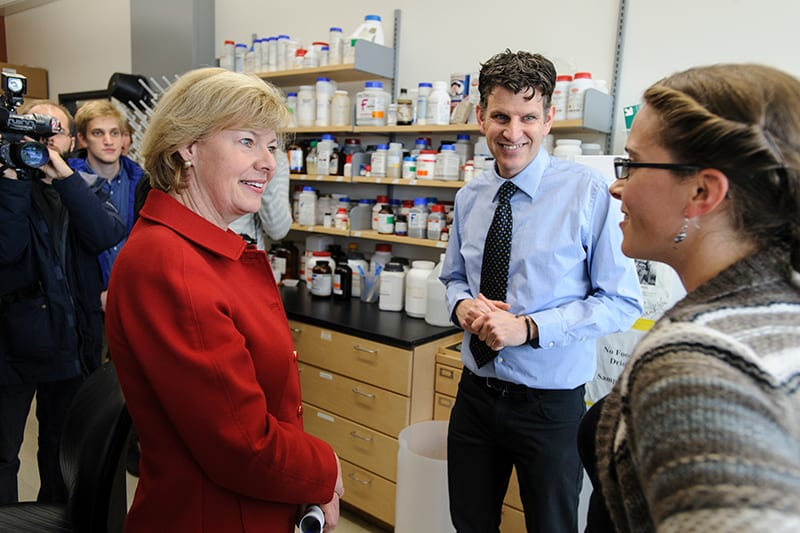 U.S. Sen. Tammy Baldwin during a 2013 visit to the lab of Cameron Currie, professor of bacteriology, in the Microbial Sciences Building. PHOTO: JEFF MILLER