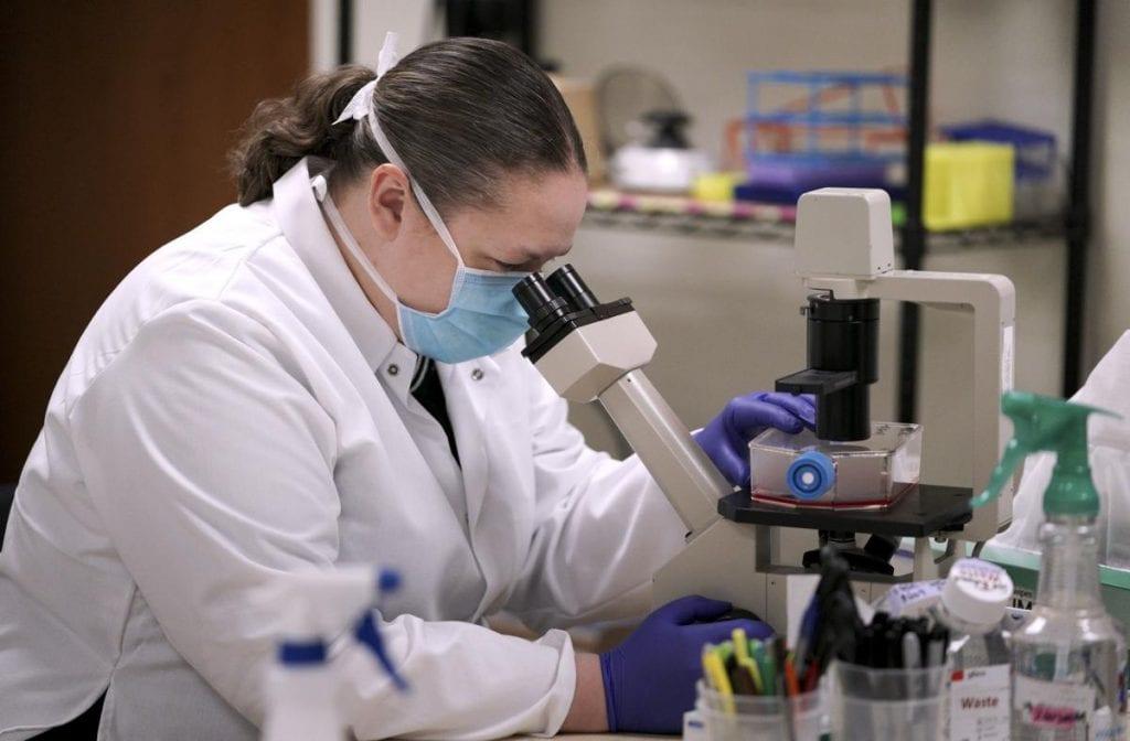Lindsay Hill-Batorski works on an experimental flu vaccine at Madison-based FluGen.