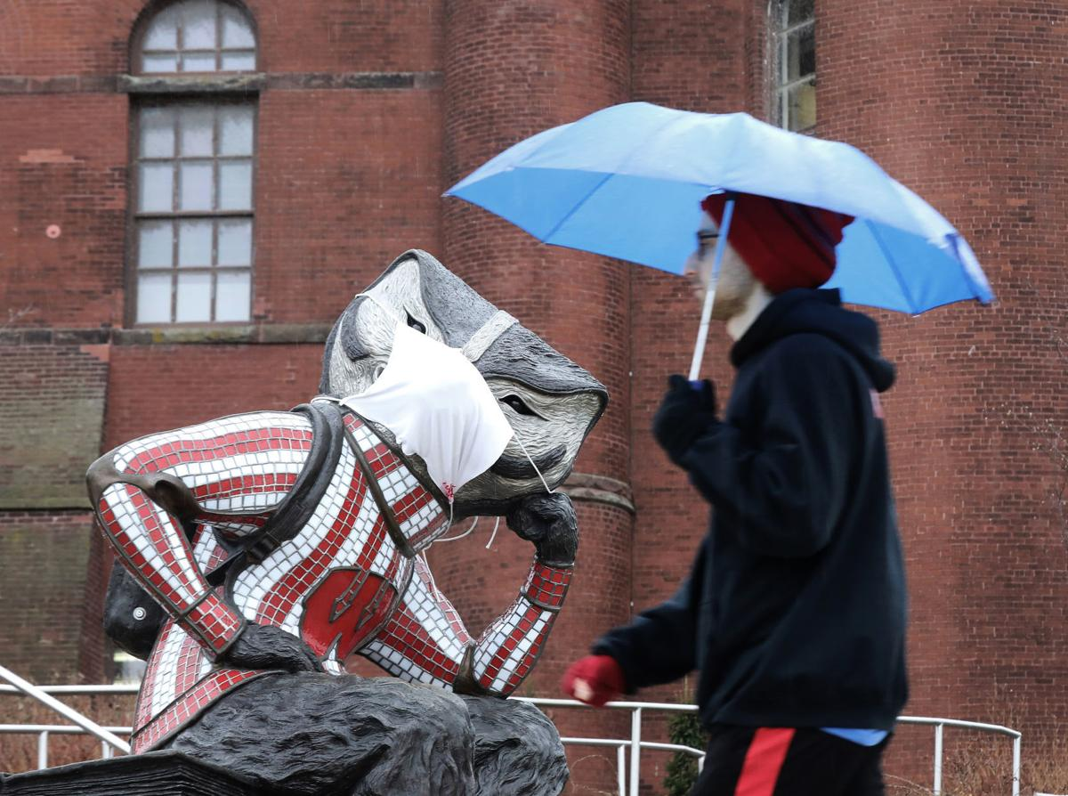 A statue of Bucky Badger on UW-Madison's campus wears a makeshift face mask. The UW Board of Regents passed a mask requirement at a meeting Thursday. JOHN HART, STATE JOURNAL