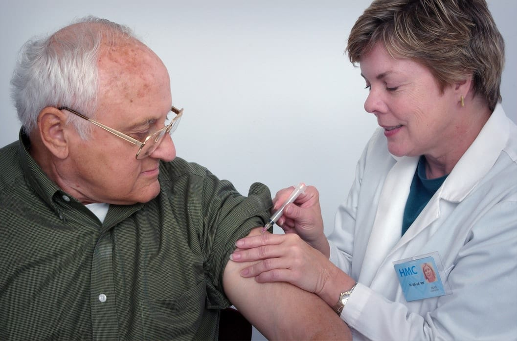 doctor giving vaccine