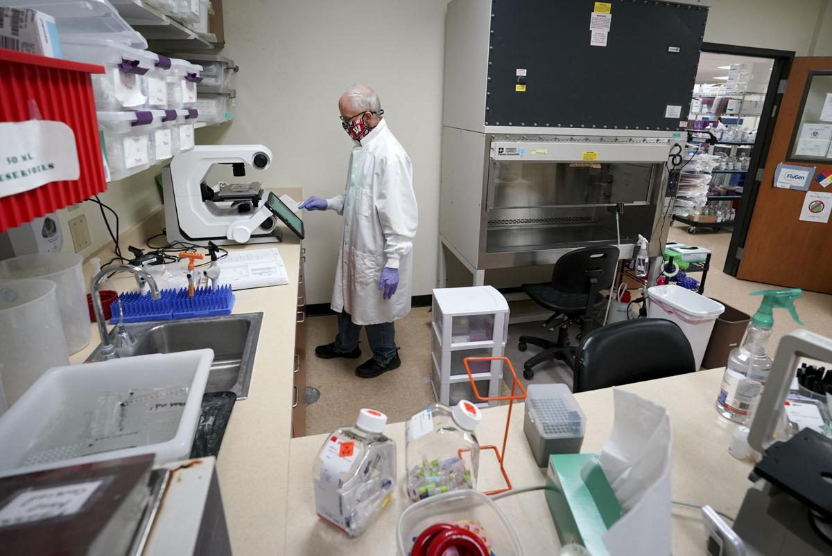 FluGen scientists, including Mike Moser, are working on two experimental vaccines, one for flu and another against the new coronavirus, which also might protect against flu. STATE JOURNAL ARCHIVES