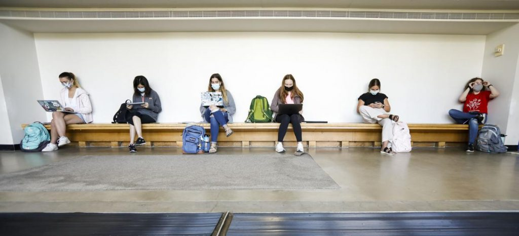 Students wear masks inside of the Mosse Humanities Building as they await their next classes on the first day of the fall semester at University of Wisconsin-Madison. RUTHIE HAUGE